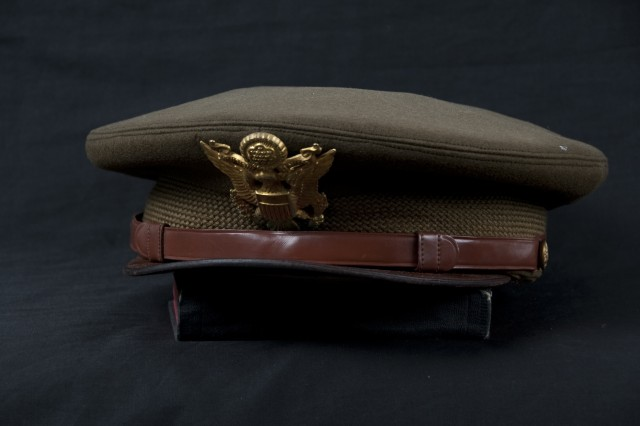 This hat was worn by Chaplain Kapaun during his period of service, between 1944-1946 during WWII. Following his service in WWII, Chaplain Kapaun earned a Master's Degree at Catholic University in Washington, DC. Kapaun wrote his Bishop in Wichita, Kan., during the course of his studies, and requested permission to return to military duty as a chaplain. At the end of his studies, The Bishop instead assigned Kapaun to a parish in Timken, Kan. After six months as pastor at Timken, Kapaun again wrote to the bishop that while he loved his work in Timken, his conscience told him that his priestly duty was in the Service. The bishop granted his request and Chaplain Kapaun reenlisted in the United States Army in late 1948.