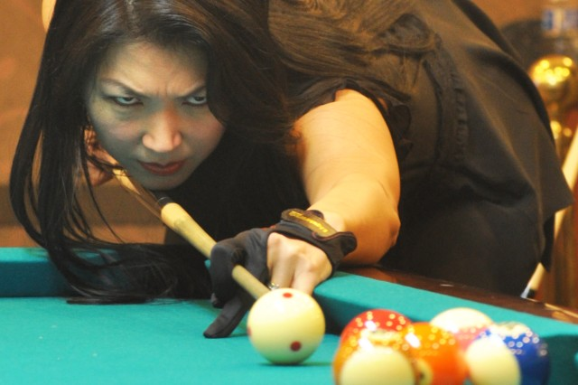 """Jeanette Lee, """"The Black Widow,"""" demonstrates a trick shot during her visit to USAG Yongsan at the R & R Bar & Grill, April 5. (U.S. Army photos by Sgt. Kevin Frazier)"""