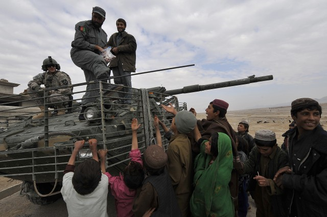 Soldiers in Afghanistan are getting improved behavioral health care, according to Lt. Gen. Patricia D. Horoho, commander, Army Medical Command. Here, Afghan police give candy to children from an Army Stryker vehicle in Hutal, Kandahar, Afghanistan.