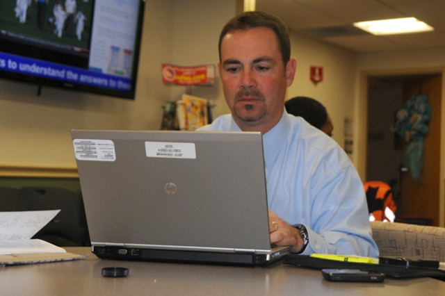 Jeff Graham, civilian, completes work on his laptop and smart phone at the Coffee Zone April 5 in Lyster Army Health Clinic while.
