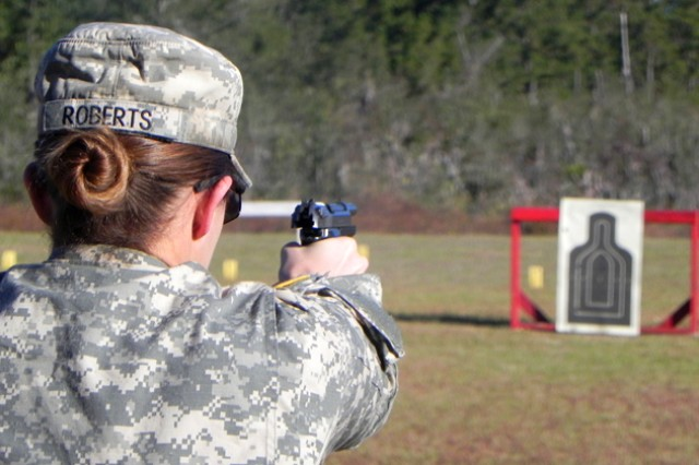A female Soldier competes in last year's rotation of the German Armed Forces Proficiency Badge at the pistol range during the 9mm Beretta portion of the competition.