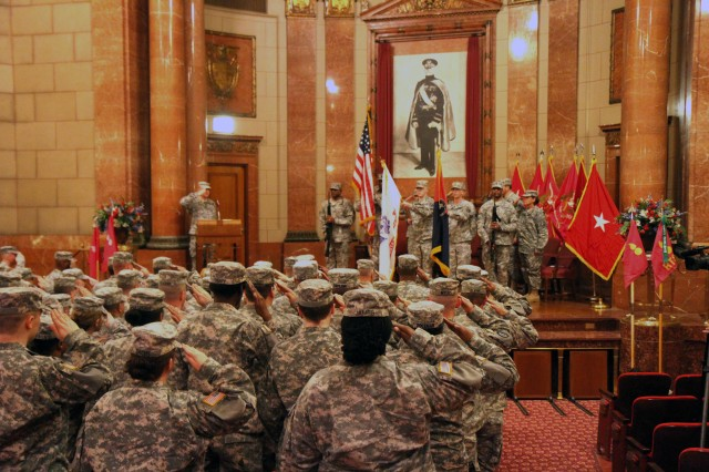 Soldiers assigned to the the 3rd Brigade (OD) 94th Training Division (FS) salute the colors during the change of command ceremony held at the Indiana War Memorial Museum April 6, 2013. During the ceremony, Col. Edward DeLisso relinquished command of the 3rd Brigade (Ordnance), 94th Training Division (Force Sustainment) to Lt. Col. Edwin Lugo during a change of command ceremony at the Indiana War Memorial Museum.