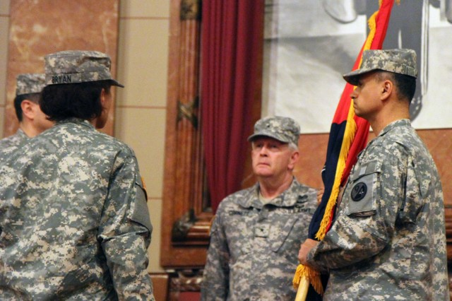 Lt. Col. Edwin Lugo, incoming commander of the 3rd Brigade (OD), 94th Training Division (FS) receives the colors from Brig. Gen. Don Cornett, Jr., commander, 94th Training Division (FS), during the change of command ceremony held at the Indiana War Memorial Museum April 6, 2013.
