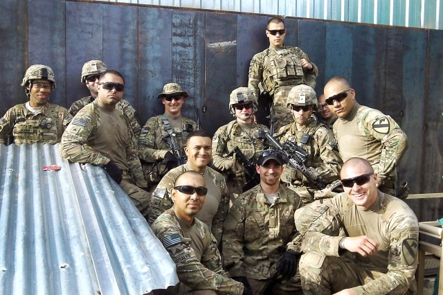 Soldiers and RFAST-C team members stand in front of the newly constructed wall at the Security Forces Advise and Assist Team-8 compound. Front row, from left: Staff Sgt. Nicholas Rosales, Sgt. Mario Palomo, RFAST-C mechanical engineer Nick Merrill, Spc. Benjamin Dininger. Middle row, from left: Sgt. Jason Aguilar, 2nd Lt. Andrew Stephens, Capt. Mitchell Monette, Staff Sgt. Joshua Debaun. Back row, from left: Staff Sgt. Terry Draper, Sgt. Walter Napier, Maj. Richard Thompson, Spc. Ryan Lucero, Capt. Andrew Spiess.