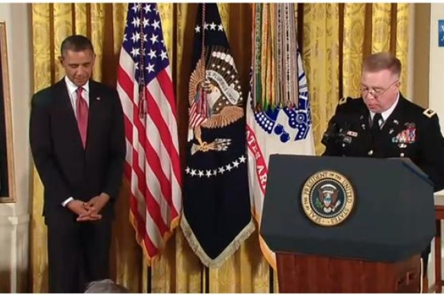 Chaplain (Major General) Donald Rutherford prays at Medal of Honor ceremony