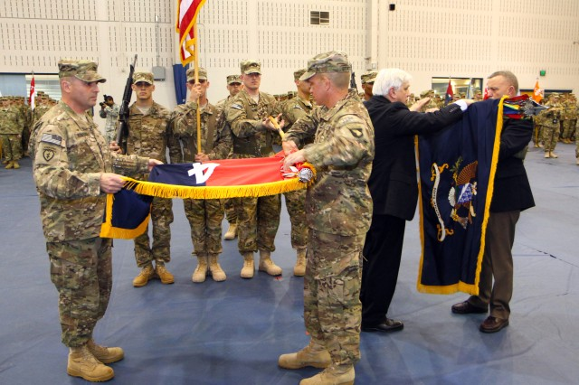 FORT CAMPBELL, Ky-U.S. Army Col. Val C. Keaveny, Jr., the commander of 4th Brigade Combat Team, 101st Airborne Division, and Command Sgt. Major Michael A. Grinston, the brigade command sergeant major of 4th BCT, 101st Abn. Div., case the brigade's colors during a casing ceremony, April 11, 2013, inside the Freedom Fighter Gym at Fort Campbell, Ky. Retired U.S. Army Col. Bob Sietz, the honorary commander of the 506th Infantry Regiment, and retired U.S. Army Command Sgt. Major Charles W. Fitzpatrick, the chief of Plans and Operations for the Fort Campbell Kinnard Mission Training Complex and a Distinguished Member of the 506th Infantry Regiment, furl the regimental colors. (U.S. Army photo by Spc. Justin A. Moeller, 4th Brigade Combat Team Public Affairs)
