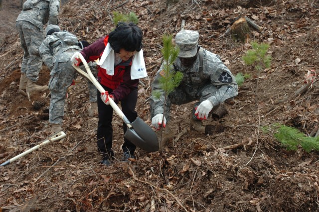 Warrior Brigades plant trees for Arbor Day