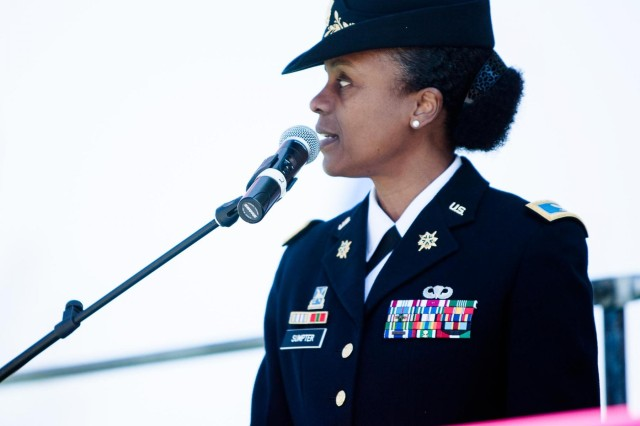 U.S. Army Col. Fern O. Sumpter, Joint Base Myer-Henderson Hall commander, speaks during the opening of the Southwest Waterfront Fireworks Festival in Washington, D.C., April 6, 2013.