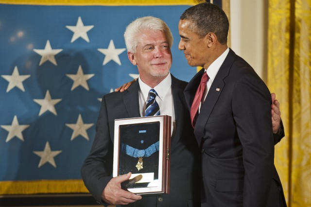 President Barack Obama awards the Medal of Honor to Chaplain (Capt.) Emil J. Kapaun, accepted posthumously by his nephew Ray, during a ceremony in the East Room of the White House, Washington, D.C., April 11, 2013.