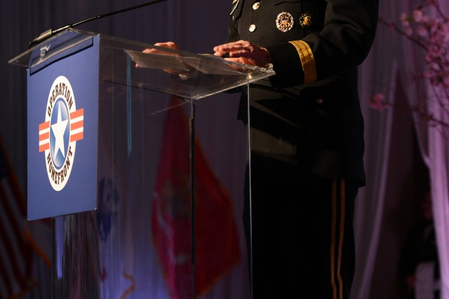 Chairman of the Joint Chiefs of Staff Gen. Martin Dempsey honors the achievements of military children at Operation Homefront's 2013 Military Child of the Year award ceremony in Arlington, Va., April 11, 2013.