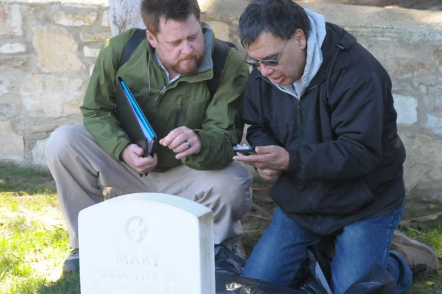 PRESIDIO OF MONTEREY, Calif. - Michael Bello, Presidio of Monterey Directorate of Public Works, enters grave marker information into a smart phone under the tutelage of Installation Management Command team member Roger Gragg. The project supports the Army's efforts to bring graves record keeping into the 21st century.