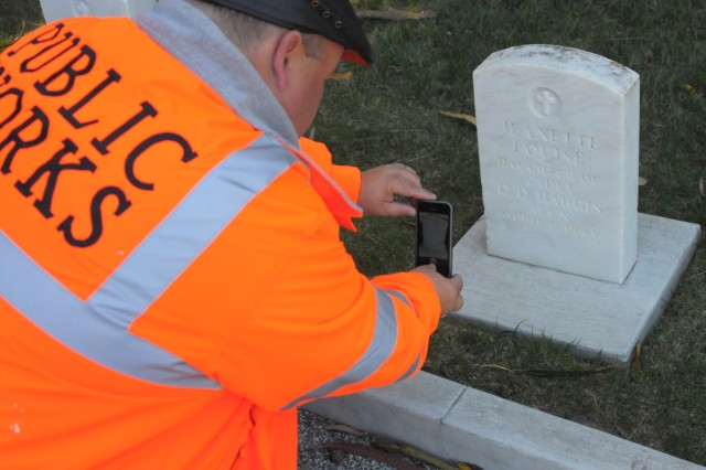 PRESIDIO OF MONTEREY, Calif. - Donald L. Gibeson, Presidio of Monterey Directorate of Public Works, performs a quality check on a photo of a grave marker at the Presidio's cemetery. The project supports the Army's efforts to bring graves record keeping into the 21st century.