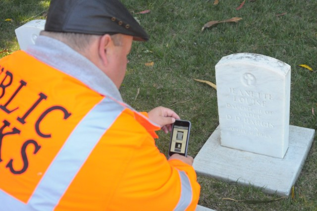 PRESIDIO OF MONTEREY, Calif. - Donald L. Gibeson, Presidio of Monterey engineering technician, enters information into a smart phone at the Presidio's cemetery. The project supports the Army's efforts to bring graves record keeping into the 21st century.