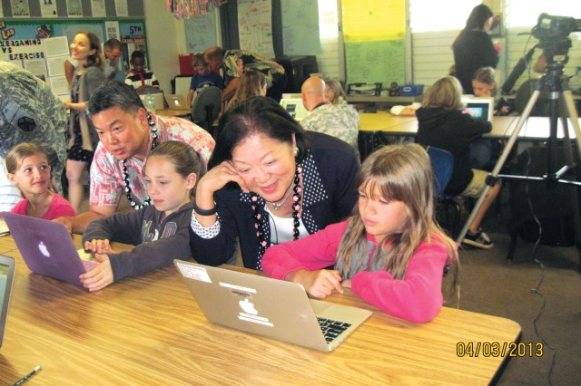 Hale Kula Elementary School students share their electronic portfolios with U.S. Sen. Mazie Hirono (right) and Hawaii State Rep. K. Mark Takai during a visit to the school, April 3, 2013.