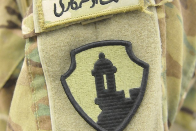 Close up photo of the US Army Reserve-Puerto Rico, 1st Mission Support Command, uniform patch. The symbol of the Sentry tower or Garita always has been seen as a true and genuine symbol of the Puerto Rican military tradition, same as with the 65th Infantry Regiment.