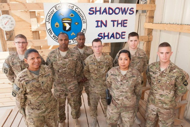 U.S. Army members of the Junior Enlisted Council, 6th Battalion, 101st Combat Aviation Brigade, 101st Airborne Division (Air Assault), stand on the outdoor relaxation area that they suggested to their senior leaders and built for the morale of all soldiers in their units, March 31, 2013. The JEC is a proactive council whose mission is to inform senior leaders of enlisted-force matters including morale and recommended policy changes. (U.S. Army photo by Sgt. Julieanne Morse, 129th Mobile Public Affairs Detachment/RELEASED)