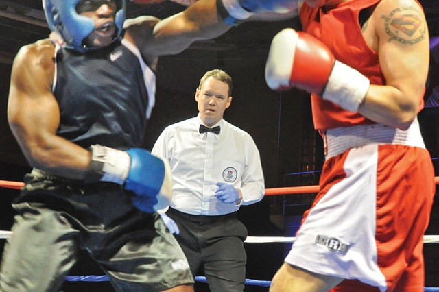 Nathaniael Barnd (left) trades punches with Manuel Valdez during the Black History Month Boxing Tournament in Wiesbaden.
