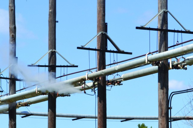 Old steam lines wait for removal by contractors in the production areas at Pine Bluff Arsenal. Two miles of lines are still waiting for removal.