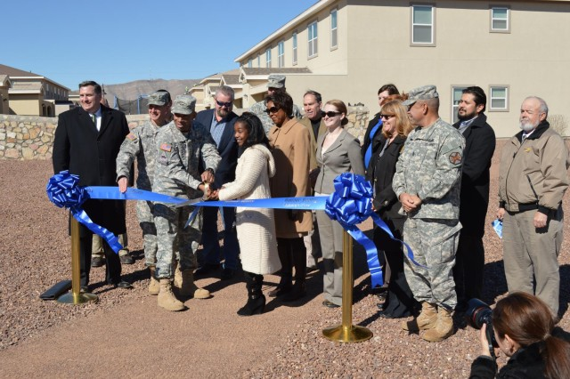 Members of the Fort Bliss community and Balfour Beatty Communities conduct a ribbon cutting for the solar panel project at Fort Bliss, Texas housing communities, Feb. 26, 2013.  The completed project, totaling 13.2 megawatts in size, will surpass the largest solar powered community built to date by 5.2 megawatts.  (U.S. Army photo by Sgt. Barry St. Clair/Released)