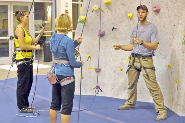 Kenneth Coppedge, an outdoor recreation program manager at Fort Bliss, instructs the Women on Rope course at the Soldier Activity Center Dec. 3. Southwest Adventure hosts the two-hour instructional course for the third time at the recreational center.