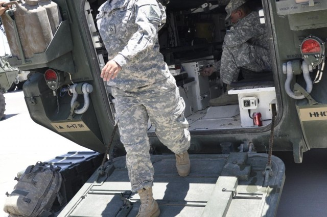 Pfc. Ana G. Walker, 1st Brigade Combat Team, 1st Armored Division, a Army mechanic from Buenos Aires, Argentina, dismounts from a Stryker combat vehicle, during pre-deployment Tactical Combat Casualty Care  for the Female Engagement Team, on East Fort Bliss, Texas.