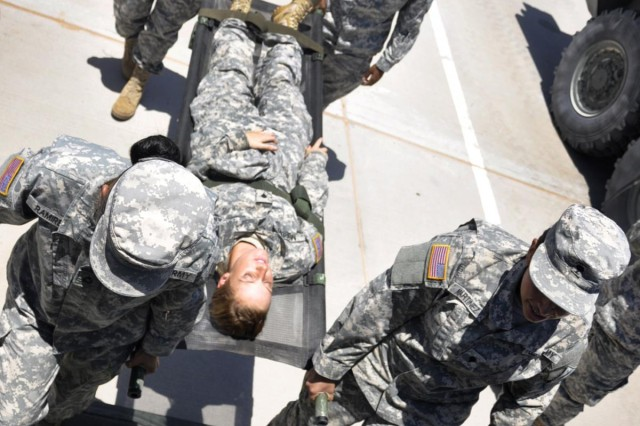Cpl. Dariel Trinidad, medic with the 1st Brigade Combat Team, 1st Armored Division, trains the Female Engagement Team, on East Fort Bliss, Texas, for a slated deployment in 2013.
