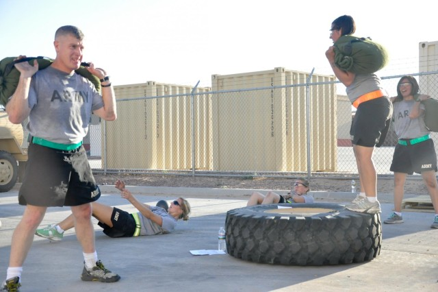Brig. Gen. Wayne W. Grigsby Jr., deputy commanding general ofthe 1st Armored Division, joins the Female Engagement Team for physical training with the 4th Battalion, 17th Infantry Regiment, on East Fort Bliss, Texas.