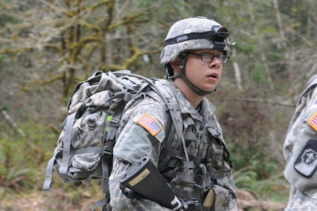"JOINT BASE LEWIS-MCCHORD, Wash. ""   Sgt. Andrew Lester, 56th Multifunctional Medical Battalion, 62nd Medical Brigade, finishes a 12-mile road march as part of Expert Field Medical Badge qualification, April 12. Of the 246 medical Soldiers from across the U.S. who attempted to earn the EFMB, 33 candidates including Lester qualified on the last day. (Photo by Staff Sgt. Mark Miranda, 5th Mobile Public Affairs Detachment)"