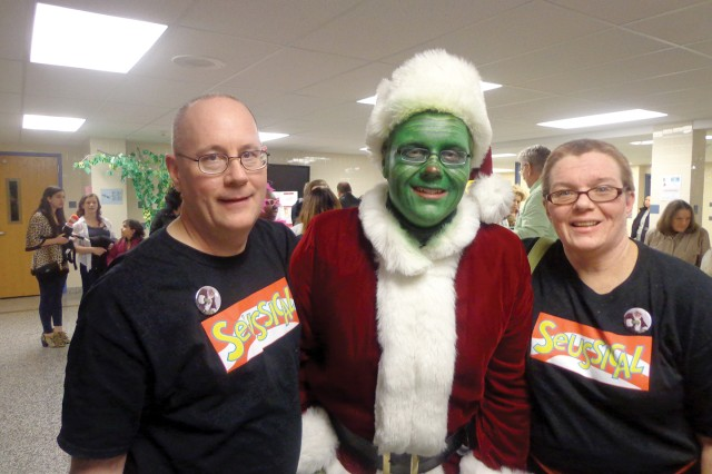 "Brian Walsh, dressed as the Grinch, poses for a photo with his parents, Chaplain (Lt. Col.) Terrence Walsh and Kathy Walsh, after his performance in ""Seussical"" last month. Brian, 17, was diagnosed with autism as a toddler, which affected his ability to communicate."
