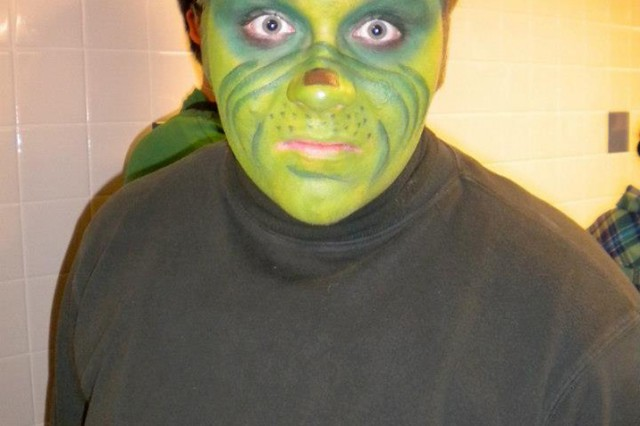 Brian Walsh, 17, poses for a photo after becoming the Grinch.