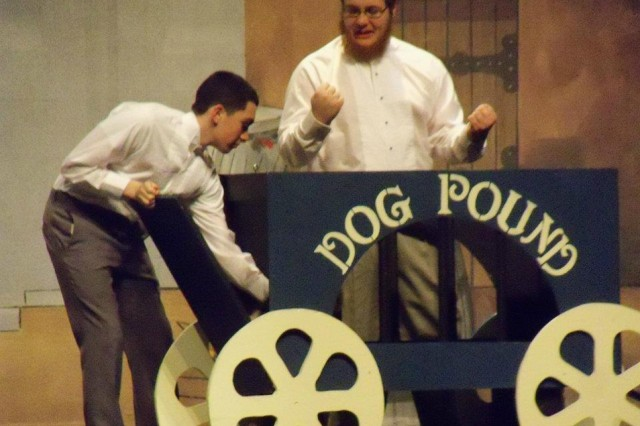 "Brian Walsh, right, plays the dog catcher during Indian River High School's theater production of ""Annie"" last year."