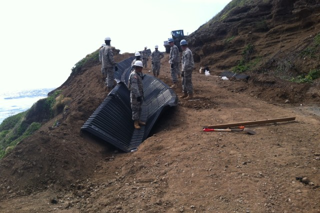 """The Soldiers of the 561st Engineer Company, 84th Engineer Battalion, 130th Engineer Brigade, 8th Theater Sustainment Command, work to emplace over 600 feet of SmartDitch"""" while helping out the Kaneohe Marine Corp Range Facility with horizontal construction. This was the first time the unit has used these materials and learned many lessons to pass on to other units in the future."""