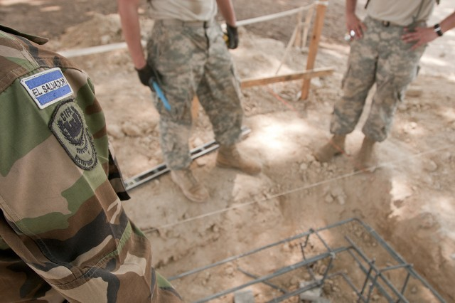 Salvadoran and U.S. soldiers take a break after tying rebar together that will support a concrete slab at a new school being built here, April 9. Soldiers of the 160th Engineer Company and their Salvadoran counterparts are working together during Beyond the Horizon-El Salvador to build three schools and three latrines in areas that need it.