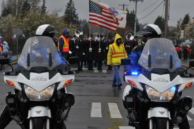 The I Corps Honor Guard and 56th Army Band along with 60 soldiers from Joint Base Lewis-McChord, Wash., led the Daffodil Parade April 13, Puyallup, Wash. About 80,000-90,000 people showed up to celebrate the parade's 80th anniversary despite the cold weather, rain and freezing wind. (U.S. Army photo by Staff Sgt. Miriam Espinoza-Torres, 5th Mobile Public Affairs Detachment)
