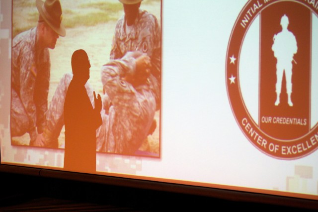 Gen. Robert Cone, commander of the Training and Doctrine Command, is silhouetted on a screen as he speaks Tuesday to Army ROTC Cadets. Photo by Steve Arel/U.S. Army Cadet Command