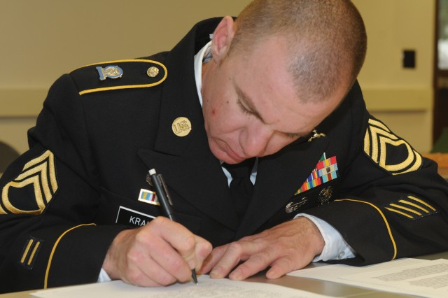 Sergeant 1st Class Chad Krause, 102nd Training Division, writes a two-page essay explaining what one line he selected from the noncommissioned officers creed means to him during the 80th Training Command (TASS) 2013 Best Warrior Competition Fort Leonard Wood, Mo., April 16, 2013.