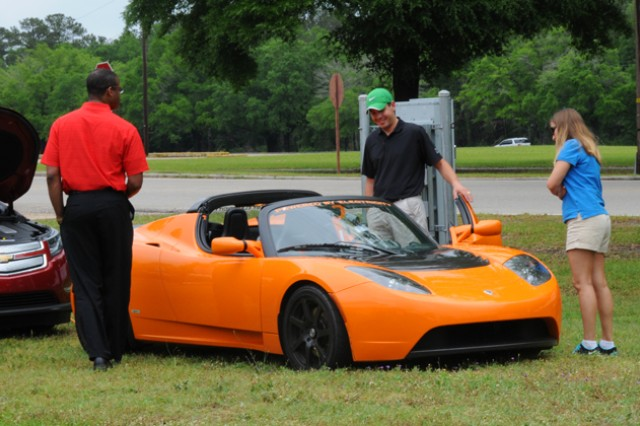 Greg and Elena Norman take a look at the Tesla, the all-electric sports car, at last year's Earth Day event. This year, Fort Rucker will host its Earth Day Expo April 24 from 10 a.m. to 3 p.m. at the festival fields.