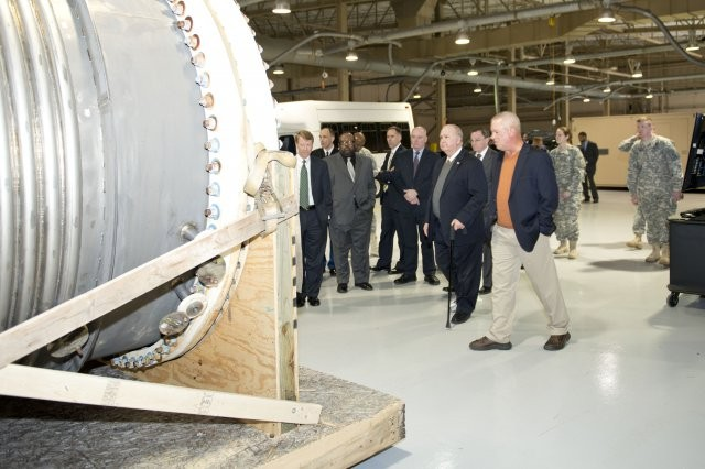 Tim Blades, CBARR director of operations, shows Under Secretary of the Army, Dr. Joseph Westphal, ECBC's field equipment during a March 28 tour.