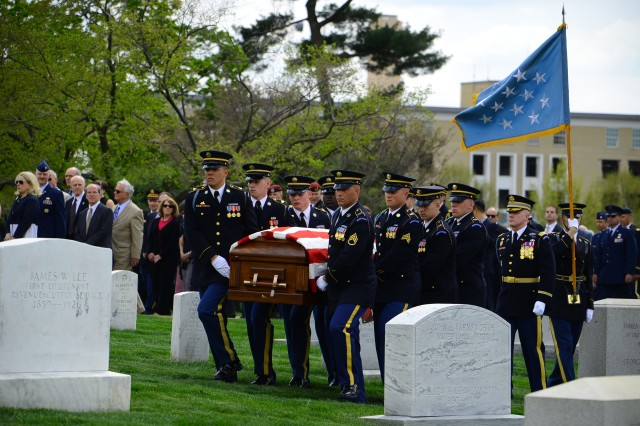 Soldiers of the Caisson Platoon, 3d U.S. Infantry Regiment (The Old Guard), transport the remains of Lt. Col. Don C. Faith Jr. to his final resting place in Arlington National Cemetery, Va., Apr. 17, 2013.
