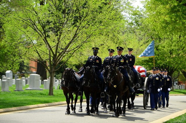 Soldiers of the Caisson Platoon, 3d U.S. Infantry Regiment (The Old Guard), transport the remains of Korean War Medal of Honor recipient Lt. Col. Don C. Faith Jr. to his final resting place in Arlington National Cemetery, Va., April 17, 2013.