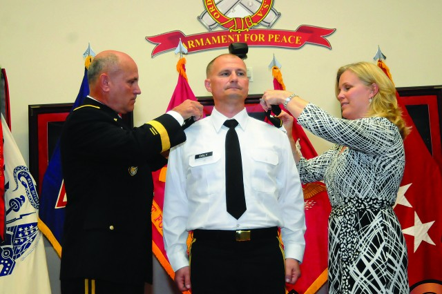 Maj. Gen. Kurt J. Stein and Cathy Daly attach one-star rank insignia to the epaulets of Brig. Gen. Edward Daly during a promotion ceremony Friday at the Ball Auditorium. Brig. Gen. Daly is currently chief of ordnance and commandant, U.S. Army Ordnance School at Fort Lee. Stein is commanding general of the 1st Sustainment Command (Theater) at Camp Arifjan, Kuwait, and Cathy Daly is Brig. Gen. Daly's wife.