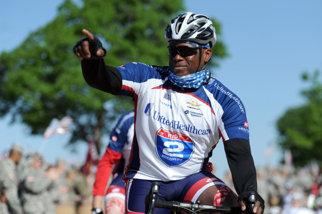 Sgt. 1st Class Corey Edwards, Fort Hood WTB, acknowledges the crowd while heading out on the route to Waco April 11. Daniel Cernero, Sentinel Sports Editor