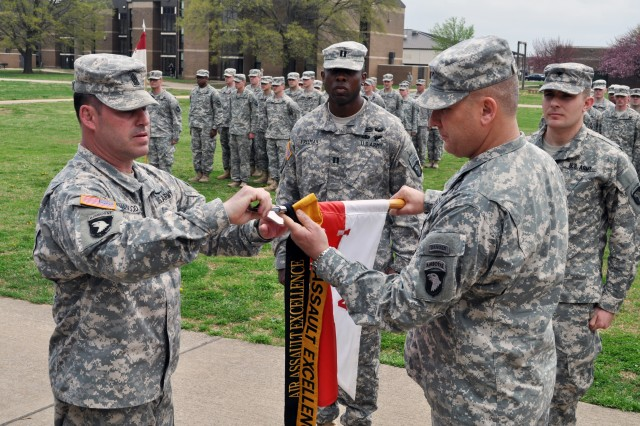 Command Sgt. Maj. Brandon Haywood (left), command sergeant major of the 2nd Brigade Combat Team, 101st Airborne Division (Air Assault), and Brig. Gen. Mark Stammer, the senior acting commander of the 101st, add the coveted Gold Air Assault Excellence Streamer to the guidon of Troop A, 1st Squadron, 75th Cavalry Regiment, 2nd BCT, 101st, during a special ceremony conducted at Strike Field, April 16. Ninety percent of the Soldiers assigned to the troop are Air Assault qualified. Currently there is no recording within the division of a gold streamer being awarded and worn by another 101st unit and the division leadership understands the importance of the troop's accomplishment.