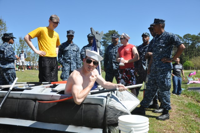 The Naval Reserve Center team prepares to race in Saturday's Recycle Regatta, one of several Green Initiative Day events at Semmes Lake.