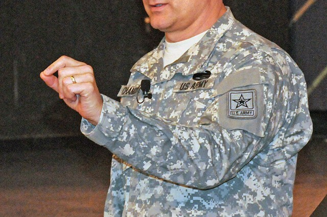 "FORT SAM HOUSTON, Texas "" Sgt. Maj. of the Army Raymond Chandler III provides his feedback and guidance as he answers April 17 during a town hall meeting at the Fort Sam Houston Theater. He was visiting FSH with Gen. Raymond Odierno, Army Chief of Staff, to speak with Fort Sam Houston's senior leaders, service members and families. ""Are you a person of character?"" asked Chandler, when talking to the audience about what he calls the three Cs: character, competence and commitment. ""Are you a person of commitment? Are we committed to looking out for each other?"""