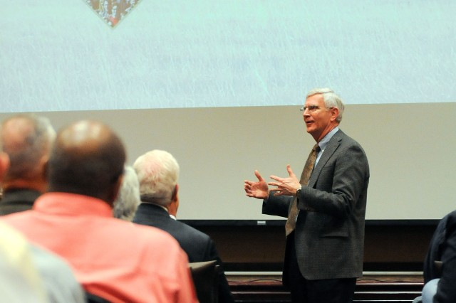 John Armbrust, executive director of the Governor's Military Council, discusses the community impact of Fort Riley and the 1st Infantry Division during a  listening session April 18 at the division's headquarters on Fort Riley. More than 300 community members attended the event designed to provide insight into the Army's upcoming troop stationing decisions.