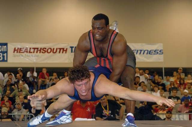 Two-time Olympian Sgt. 1st Class Dremiel Byers of the U.S. Army World Class Athlete Program at Fort Carson, Colo., lifts New York Athletic Club's Russ Davie at the 2006 U.S. National Wrestling Championship in Las Vegas.