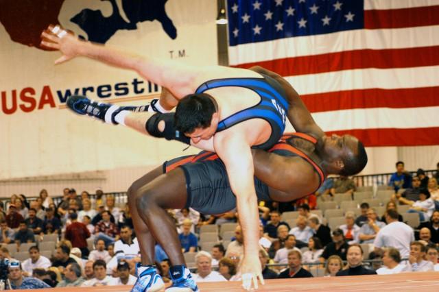 Sgt. 1st Class Dremiel Byers throws U.S. Army World Class Athlete Program teammate Sgt. Paul Devlin at the 2003 U.S. National Wrestling Championships in Las Vegas.
