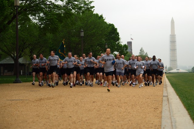 Army Reservists run the final stretch of a two-mile fun run in Washington, D.C. commemorating the 105th birthday of the Army Reserve, April 18, 2013, in Washington, D.C.