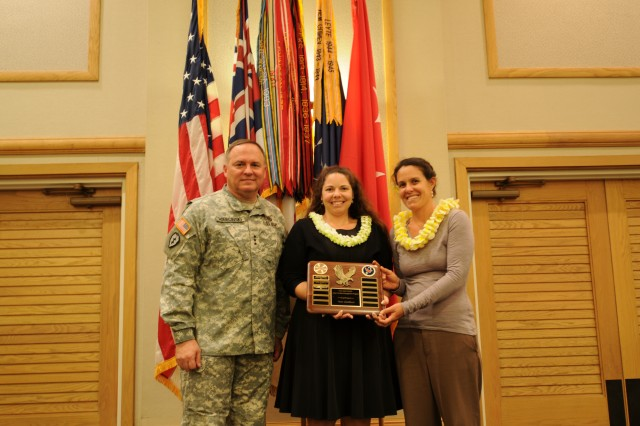 "U.S. Army Pacific, Commanding General, Lt. Gen. Francis J. Wiercinsk (left) presents ""Team Excellence Award"" to Michelle Mansker (center) and Kapua Kawelo (right) both from U.S. Army Garrison Hawaii Directorate of Public Works. The presentation was part of the Civilian Recognition Award Ceremony held April 17 at the Hale Ikena on Fort Shafter, Hawaii."
